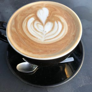beautiful latte in coffee cup
